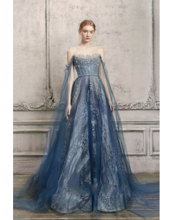 The Atelier Couture Draped Off Shoulder Illusion Gown